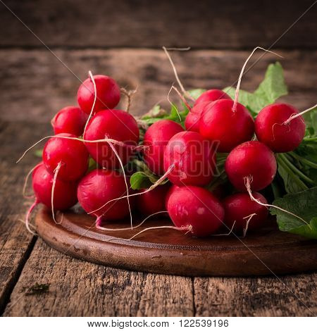 Fresh Rustic Harvest Of Radishes Healthy Vegetables In Vintage Basket Background