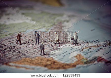 Miniature business people on top of US map. Business concept. Color tone tuned