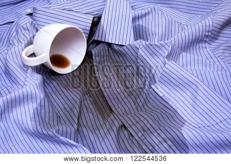 Close up photo of Coffee Spilled On A Shirt