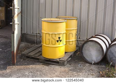 Nuclear waste stored in yellow barrel with radioactive warning sign