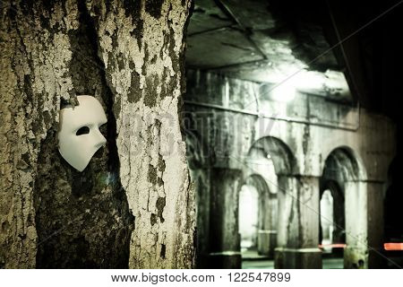 Lurking in the Shadows - Phantom of the Opera Mask in Dark Tunnel