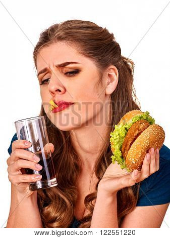 Unhappy girls holding  burger and drink cola glass. Fastfood concept. Isolated.