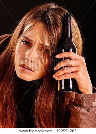 Drunk girl with long hair keeps bottle of alcohol. Soccial issue alcoholism.