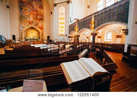 STOCKHOLM, SWEDEN - JULY 29, 2014: Open Bible book in Sofia Kyrka Church. Sofia Church named after the Swedish queen Sophia of Nassau, is one of the major churches in Stockholm, Sweden.