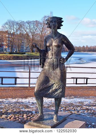 KARLSTAD, SWEDEN - FEBRUARY 21, 2016: Statue of Eva Lisa Holtzat, a Swedish waitress and innkeeper who became the symbol for the Karlstad city. She was known in Sola i Karlstad (the Sun in Karlstad).