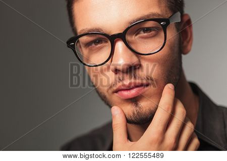 closeup portrait of a man wondering about something , studio picture