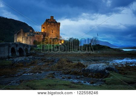 The illuminated Eilean Donan Castle during blue hour. Loch Duich, Scottish Highlands.