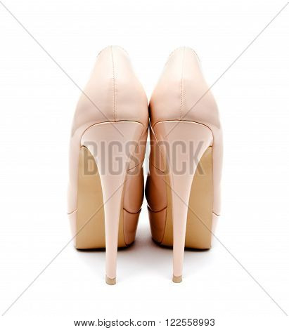 Biege high heel woman shoes isolated on a white back view