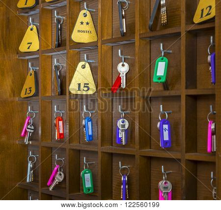 Rooms keys at a two stars hostel reception desk counter.