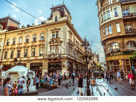 BELGRADE, SERBIA - SEPTEMBER 23: Republic Square or Square of the Republic on September 23, 2015 in Belgrade, Serbia. One of the central town squares and an urban neighborhood of Belgrade. Filtered photo with warm summer lighting.