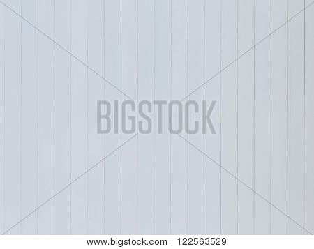 uneven surface of old white wall of light colored vertical white boards with thin seams