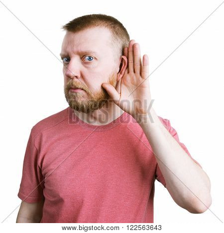 Man with a red beard is listening to something