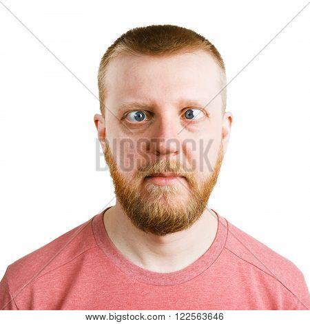 Redbeard man in a pink shirt with a sidelong glance