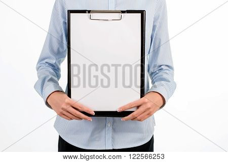 Close-up of lady's blank clipboard. Businesswoman holding blank clipboard. Contact us at any time. Place for your logo.