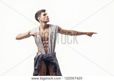 Portrait of handsome young man with half naked body, looking at camera against of white background. Smiling. Studio shot