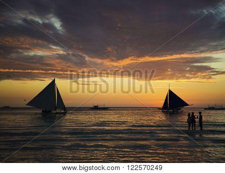 sailing boats at sunset on boracay island beach philippines
