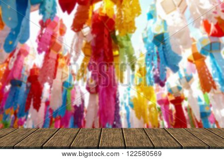 colorful paper lantern decoration for traditional Yeepeng festival in Thailand (blur background with wood table top for display or montage your product)