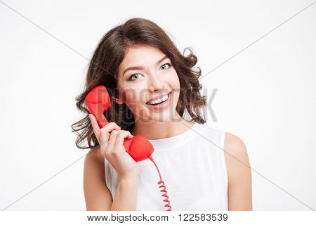 Happy young woman talking on the phone tube isolated on a white background