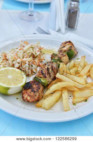 Traditional greek food - souvlaki meat with fries