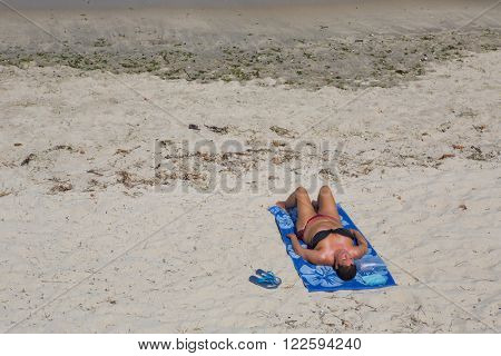 BAIONA, GALICIA, SPAIN - AUGUST 26: woman at the beach, on August 26, 2015 in Baiona, Galicia, Spain