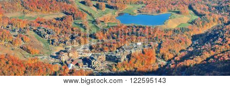 Lake with Autumn foliage viewed from mountain top in New England Stowe
