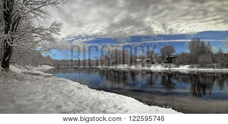 Winter landscape cloudy sky reflection in river waters. Neris river Lithuania