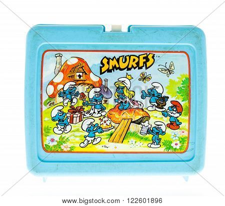 Winneconne WI - 20 April 2015: Plastic lunch box from the 1980's featuring Smurfs a popular cartoon.