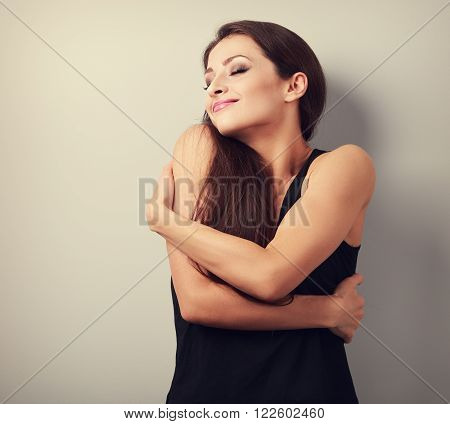 Happy Strong Sporty Woman Hugging Herself With Natural Emotional Enjoying Face. Love Concept Of Your