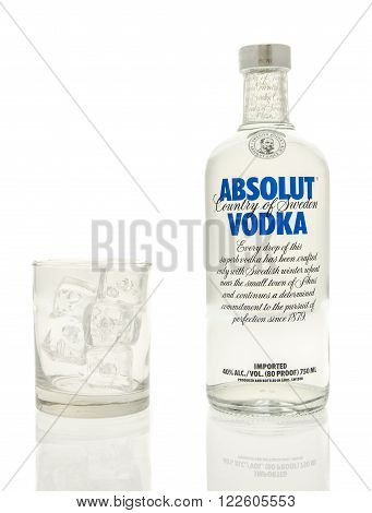 Winneconne WI - 15 March 2016: A bottle of Absolut vodka with a glass of ice