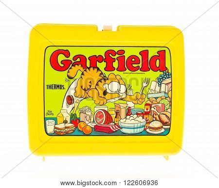 Winneconne, WI - 20 April 2015: Plastic lunch box from the 1980's featuring Garfield a popular cartoon.