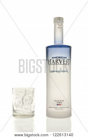 Winneconne WI - 15 March 2016: A bottle of American Harvest vodka with a glass of ice