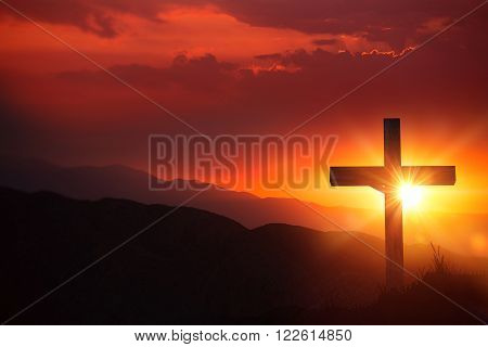 The Light of Christ Old Wooden Crucifix on the Desert During Scenic Sunset. Christian Cross Sunset Background.