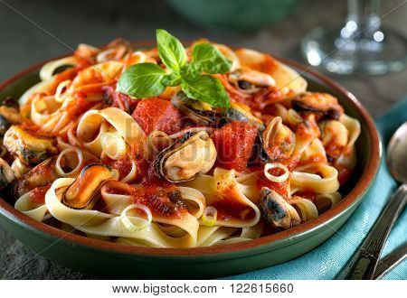 Delicious pasta with mussels in basil marinara sauce.