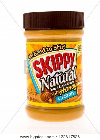 Winneconne WI - 3 May 2015: Jar of Skippy Natural peanut butter with honey in creamy style.