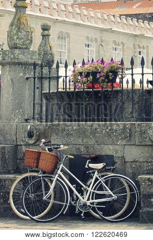 two bikes rest in a fount in Caminha, Portugal