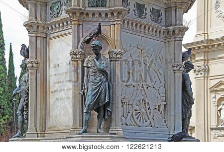Pigeons on the monument to the hero of the Risorgimento Manfredo Fanti in the center of the Piazza San Marco in Florence Italy.