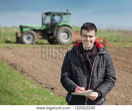 Farmer With Laptop On The Farmland