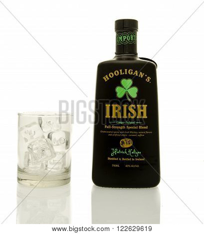Winneconne WI - 19 March 2016: A bottle of Hooligan's irish whisky with a glass of ice.