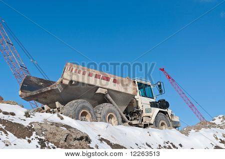 Dump Truck On A Construction Site In Winter
