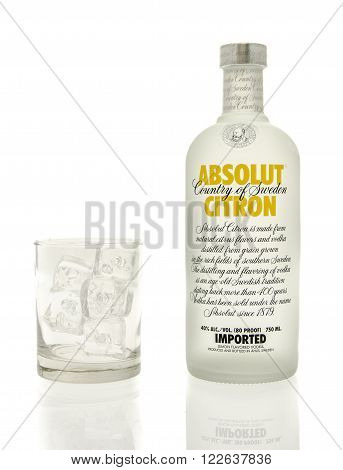 Winneconne WI - 15 March 2016: A bottle of Absolut citron vodka with a glass of ice