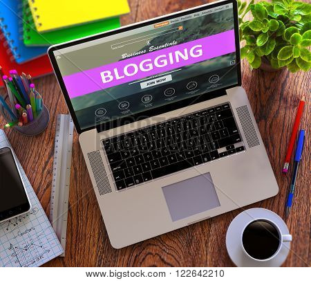Blogging Concept. Modern Laptop and Different Office Supply on Wooden Desktop background. 3D Render.