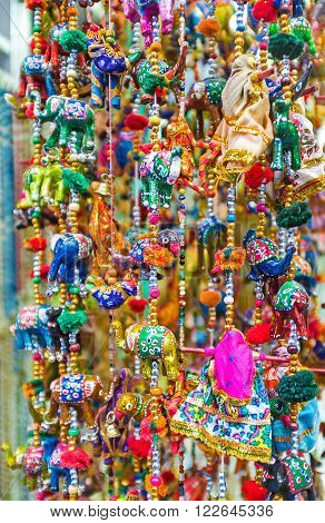 The wind chimes with colorful toys are the perfect gift Jerusalem Israel.