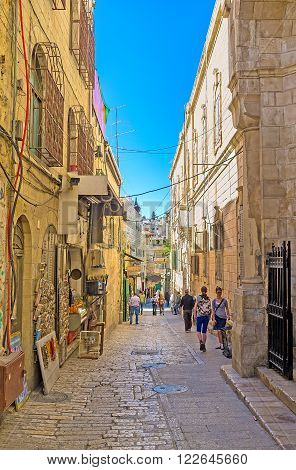 JERUSALEM ISRAEL - FEBRUARY 16 2016: The narrow Via Dolorosa is very crowded during the Christian Holidays and completely empty in low season on February 16 in Jerusalem.