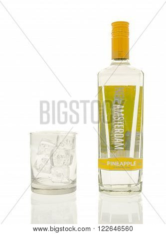 Winneconne WI - 15 March 2016: A bottle of New Amsterdam pineapple vodka with a glass of ice