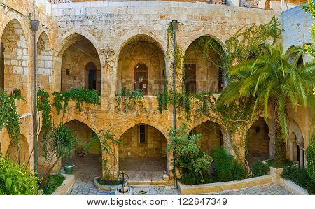 JERUSALEM ISRAEL - FEBRUARY 16 2016: Panorama of the courtyard of Lutheran Kirche of the Redeemer and its beautiful garden on February 16 in Jerusalem.