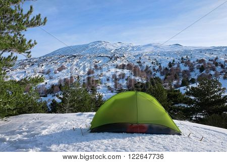 green tent in winter camp Etna National Park, Sicily