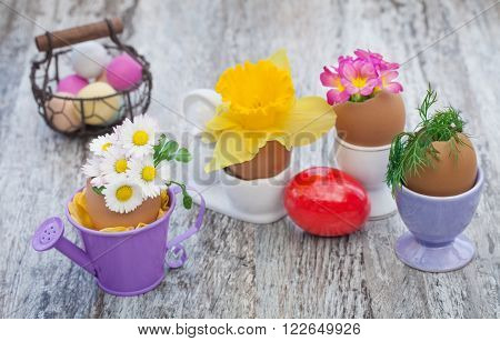 eggs, flowers and eggcup on the garden table