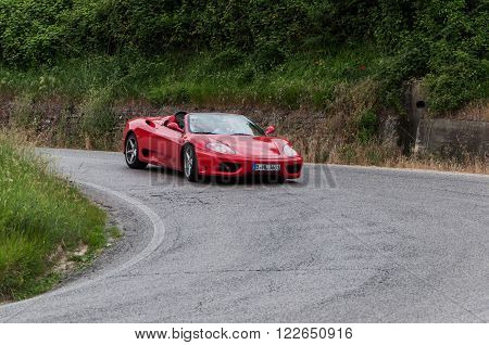 FERRARI - F 430 cabrio PESARO, ITALY - MAY 15: unidentified crew on an old racing car in rally Mille Miglia 2015 the famous italian historical race (1927-1957) on May 2015