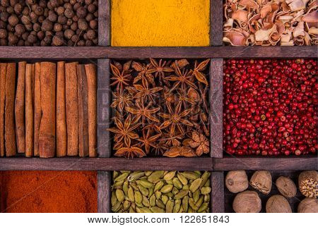 Anisetree and spices in a wooden box