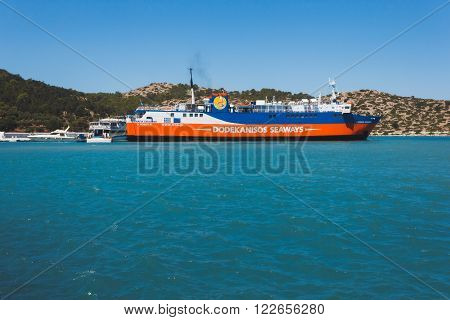 Greece, Panormitis-July 14 2014: The ferry at the pier in the port on July 14, 2014 in Panormitis, Greece